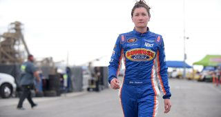 IRWINDALE, CA - MARCH 25:  Julia Landauer, driver of the Lucas Oil/Eibach/Sunrise Ford, walks in the garage during practice for the K&N West Series Napa Twins 100 at Irwindale Speedway on March 25, 2017 in Irwindale, California.  (Photo by Jonathan Moore/Getty Images) *** Local Caption *** Julia Landauer | Getty Images