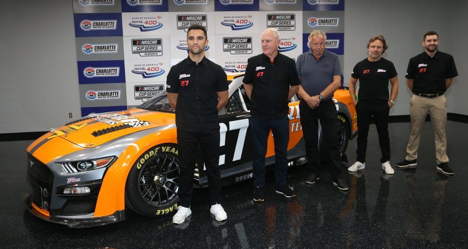 CONCORD, NORTH CAROLINA - OCTOBER 09: Driver Loris Hezemans, attends a press conference announcing he will drive the #27 Next Gen car in selected races of the 2022 NASCAR Cup Series for Team Hezeberg owners Toine Hezemans and Ernst Berg prior to the NASCAR Xfinity Series Drive for the Cure 250 presented by Blue Cross Blue Shield of North Carolina at Charlotte Motor Speedway on October 09, 2021 in Concord, North Carolina. (Photo by Brian Lawdermilk/Getty Images) | Getty Images